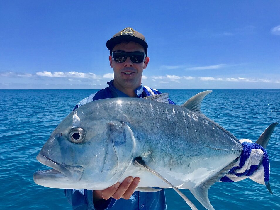 male angler with trevally fish