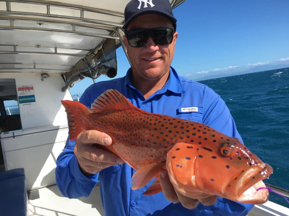 Man showing a Coral trout caught with Dragon Lady fishing charters