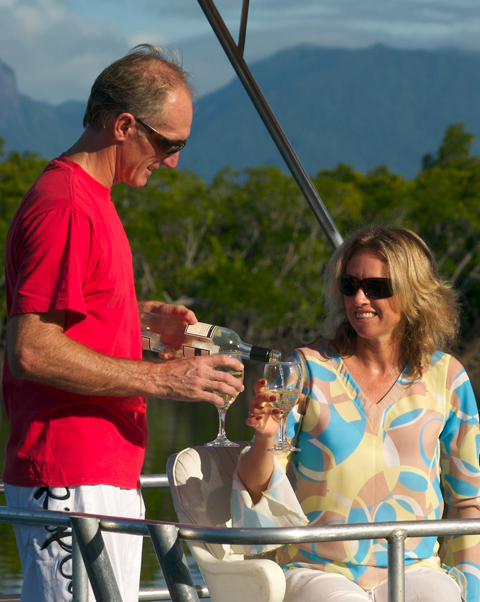 man and woman drinking wine on the Port Douglas pontoon boat
