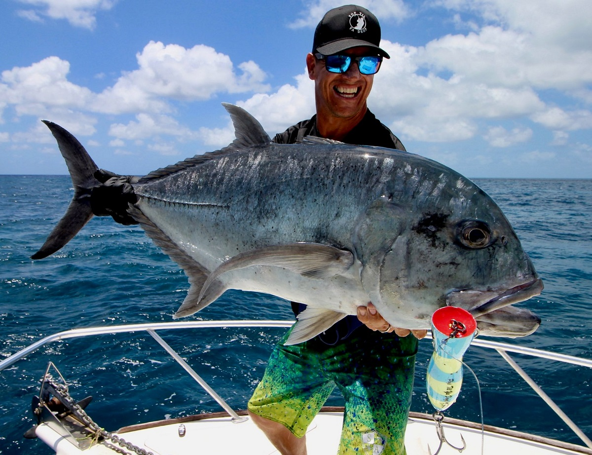Game Angler presenting a giant trevally during reef popper fishing